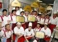 Vorschau: Das Küchenteam in der Mensa Studentenhaus feiert
